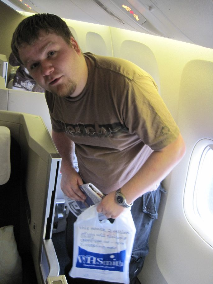 Shaun getting into his seat (cubicle) on plane