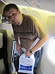members/dos_box-albums-edugeek-denver-day-1-picture7540-shaun-getting-into-his-seat-cubicle-plane.JPG